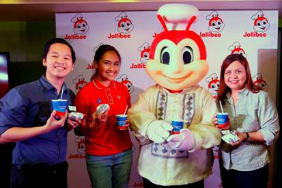 With Jollibee wearing the Barong Tagalog, (from left) Jollibee Brand Manager for Yum! Burger, Mathew Whang, Brand PR and Engagement Manager Cat Trivino, and Brand Communications Director and Head of Kids Marketing Arline Adeva holds up their newest offerings: Adobo Flakes Yum! Burger and Halo-Halo Sundae.
